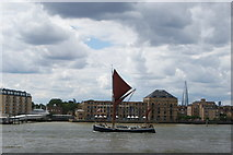 TQ3680 : View of a Thames Barge passing Canary Riverside #2 by Robert Lamb