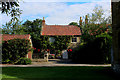 SE4976 : Cottage behind the Church at Carlton Husthwaite by Chris Heaton