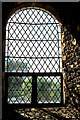 TF6602 : West window in St Andrew's Church by Tiger