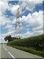 TM0572 : Electricity Pylon off the B1113 Finninghaham Road by Adrian Cable