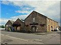 NH7168 : Former warehouses (?) High Street by Richard Dorrell