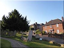 TQ1289 : St John the Baptist, Pinner: churchyard by Basher Eyre