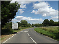 TM0890 : New Buckenham Road & roadsign by Adrian Cable