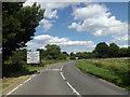 TM0890 : New Buckenham Road & roadsign by Geographer