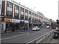 TQ4386 : Facade from 1924, shops from 21st century, Ilford by David Smith