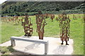 SH7578 : Seat and Statues near Conwy Morfa by Jeff Buck
