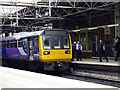 SJ8399 : A Pacer train in Manchester Victoria Station by John Lucas