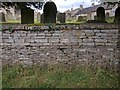 TF0516 : Churchyard wall by Bob Harvey