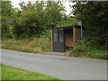 TL9875 : Bus Stop & Shelter off The Street by Adrian Cable