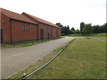 TM0890 : Entrance of New Buckenham Village Hall & Playing Field by Adrian Cable