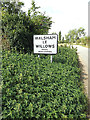 TM0271 : Walsham Le Willows Village Name sign by Adrian Cable