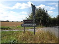TL9670 : Roadsigns on the C645 Walsham Road by Adrian Cable
