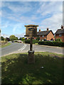 TL9174 : Honington Village sign by Adrian Cable