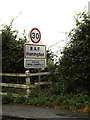 TL9073 : RAF Honington Village Name sign on Green Lane by Adrian Cable