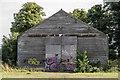 TL4264 : Barn with Graffiti by Kim Fyson