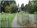 TQ2792 : Entrance to the churchyard of St James the Great, Friern Barnet by Marathon