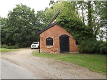 TM1587 : Building off Rectory Road by Adrian Cable