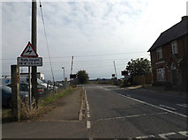 TM1587 : B1134 Station Road,  Sneath Common by Adrian Cable