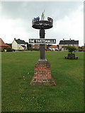TM1686 : The Tivetshalls Village sign by Adrian Cable