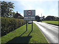 TM0691 : Old Buckenham Village Name sign by Adrian Cable