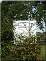 TM0691 : Old Buckenham Village Hall sign by Adrian Cable