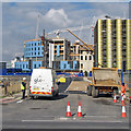 TL4654 : Blue hospital and yellow car park by John Sutton