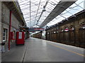 SJ7154 : Crewe railway station: looking south on platform 11 by Jonathan Hutchins