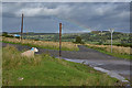 NY5215 : Road junction with sheep on Rosgill Moor by Nigel Brown