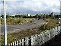 SJ7696 : Trafford: waste ground (former car park) off M60 by Jonathan Hutchins