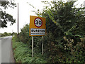 TM1483 : Burston Village Name sign on Station Road by Adrian Cable