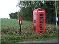 TM4281 : Elizabeth II postbox and phonebox on Moll's Lane, Brampton by JThomas