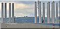 J3677 : Wind turbine masts, Belfast harbour - October 2016(5) by Albert Bridge