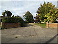 TM0691 : Old Buckenham Methodist Church entrance by Adrian Cable