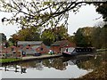 SJ8965 : Narrowboat and cow at Crossley Hall Farm by Graham Hogg