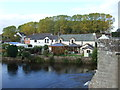 NY5228 : Houses beside the River Eamont, Eamont Bridge by JThomas
