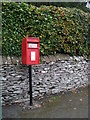 NY5423 : Elizabeth II postbox on the A6, Hackthorpe by JThomas