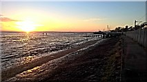 TQ8485 : Sunset between rails and the sea by Chris Morgan