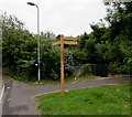 ST2995 : Wooden signpost, Woodside Road, Cwmbran by Jaggery