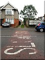 SZ1392 : West Southbourne: across 'Slow' markings and along footpath H09 by Chris Downer