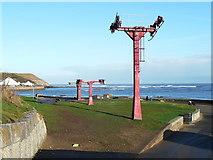 TA0390 : Disused chair lift pillars, North Bay, Scarborough by Humphrey Bolton