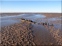 TF4544 : Wreckage on the bank by Ian Paterson