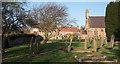 NZ1720 : Graveyard at Church of St. John the Evangelist by Trevor Littlewood