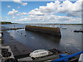 SX9781 : Starcross harbour wall at low tide by Stephen Craven