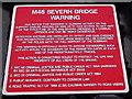 ST5689 : M48 Severn Bridge Warning notice near Aust by Jaggery