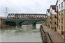 TL1998 : Railway bridges over River Nene by Robert Eva