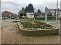 SJ6966 : Flower bed at road junction, Middlewich by Jonathan Hutchins