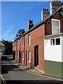 SY2998 : Row of brick houses, Church Street, Axminster by Jaggery