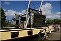 SJ5848 : Narrowboat passes under Wrenbury Bridge by Christopher Hilton