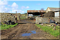 NY9712 : Outbuildings at West Charity Farm by Chris Heaton
