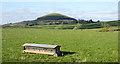 NZ4800 : Field with animal feeder by Trevor Littlewood